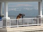 Free Stock Photo: Tourist looking through telescope at Stone Mountain Park