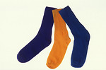 Free Stock Photo: Blue and orange cotton socks isolated on a white background