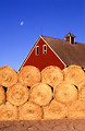 Free Stock Photo: Bales of hay stacked outside a barn