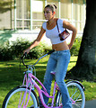 Free Stock Photo: A beautiful girl on a pink bike
