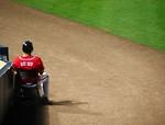 Free Stock Photo: A baseball bat boy sitting on the sideline