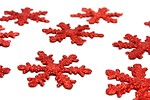 Free Stock Photo: Red snowflake shaped Christmas ornaments isolated on a white background