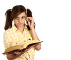 Free Stock Photo: A smart girl with glasses reading a book