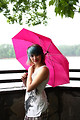 Free Stock Photo: A beautiful young woman posing with an umbrella