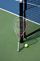 Free Stock Photo: A tennis racquet and ball on a tennis court