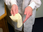 Free Stock Photo: A lab technician pulling off disposable gloves