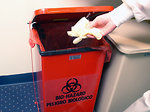 Free Stock Photo: A lab technician discarding disposable gloves