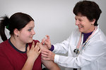 Free Stock Photo: A girl receiving a vaccination shot from her doctor