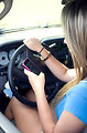 Free Stock Photo: A teen girl texting while driving