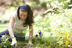 Free Stock Photo: A woman enjoying gardening outdoors