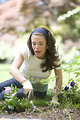 Free Stock Photo: A woman enjoying gardening outdoors