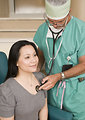 Free Stock Photo: A doctor examining a female patient