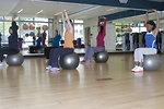 Free Stock Photo: A group of women doing aerobics
