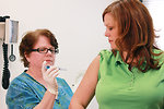 Free Stock Photo: A nurse giving a woman a flu vaccine shot