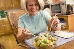 Free Stock Photo: A woman eating a fresh salad