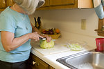 Free Stock Photo: A woman preparing a salad in her kitchen