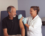 Free Stock Photo: A nurse administering a vaccine to a male patient