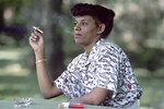 Free Stock Photo: An African American woman smoking a cigarette