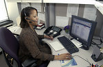 Free Stock Photo: An African American woman working at her desk