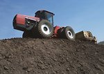 Free Stock Photo: A tractor moving topsoil on a hill