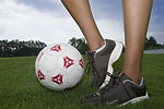 Free Stock Photo: Female legs and a soccer ball