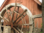 Free Stock Photo: Side view of a red bar with a dry water wheel