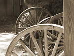 Free Stock Photo: Black and white picture of wooden wheels and hay in a barn