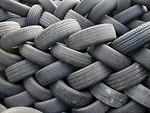Free Stock Photo: A wall of piled car tires