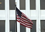 Free Stock Photo: US flag in front of a white building