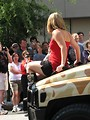 Free Stock Photo: Girl on the hood of a military truck in 2008 Dragoncon parade