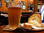 Free Stock Photo: A glass of beer and bread in a bar