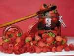 Free Stock Photo: A pile of strawberries and a jar of jam