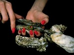 Free Stock Photo: Close-up of a woman opening an oyster
