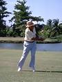 Free Stock Photo: An older man swinging a golf club
