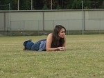 Free Stock Photo: A beautiful teen girl lying in the grass