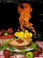 Free Stock Photo: Display of apples and a pie in front of a fire