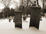 Free Stock Photo: Black and white old tombstones in a snow covered graveyard