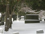 Free Stock Photo: A snow covered tombstone in a graveyard