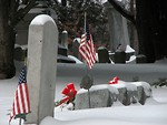 Free Stock Photo: US flags and tombstones in a snow coverd graveyard