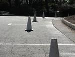 Free Stock Photo: White construction pylons blocking empty parking spaces