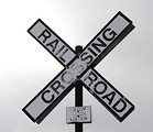 Free Stock Photo: A railroad crossing sign in a cloudy sky