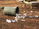 Free Stock Photo: Trash spilling out of a tipped over trash can