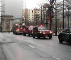 Free Stock Photo: A firetruck and rescue vehicles in the 2009 Atlanta Saint Patricks Day Parade