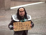 Free Stock Photo: A man in a Klingon costume with sign in the rain in the 2009 Atlanta Saint Patricks Day Parade