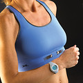 Free Stock Photo: Closeup of an older woman wearing a blue sports bra and watch