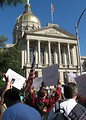 Free Stock Photo: Protest flags and signs in front of the State Capitol building at the 2009 tax day tea party in Atlanta, Georgia