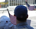 Free Stock Photo: Protesters with flags in their hats at the 2009 tax day tea party in Atlanta, Georgia