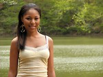 Free Stock Photo: Portrait of a beautiful African American teen girl posing by a lake