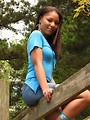 Free Stock Photo: Portrait of a beautiful African American teen girl posing on a wooden fence