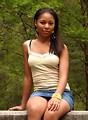 Free Stock Photo: A beautiful African American teen girl posing in the woods